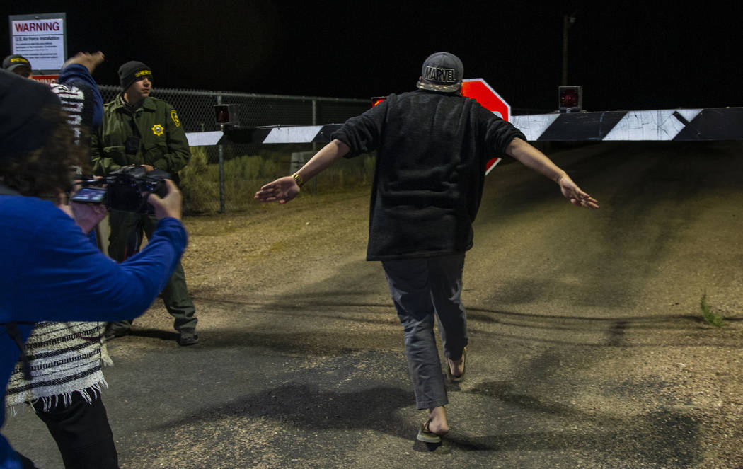 An attendee runs towards the back gate of Area 51 in homage to the original Storm Area 51 idea ...