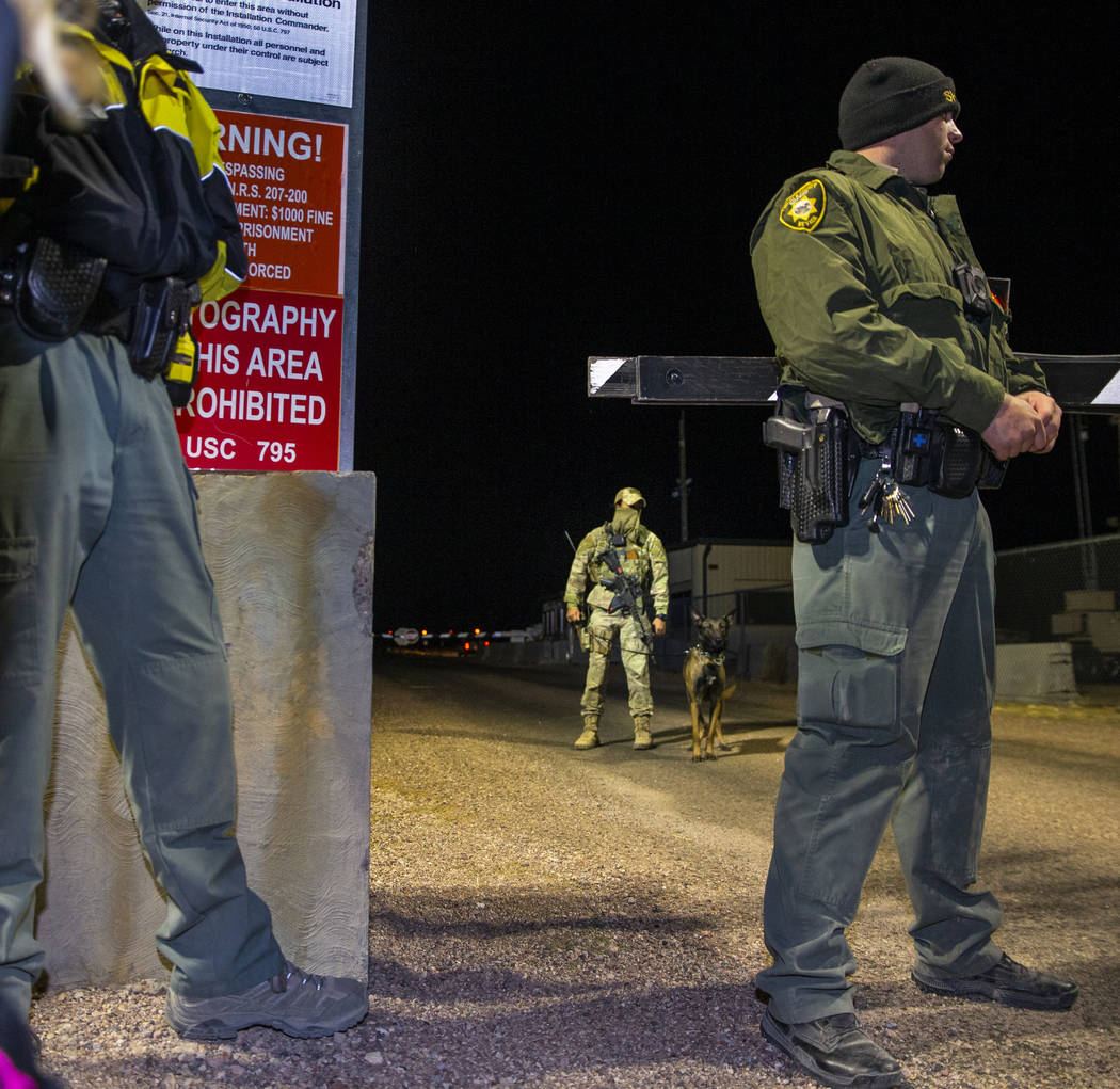 Security personnel patrol the back gate of Area 51 to monitor individuals there in homage to th ...