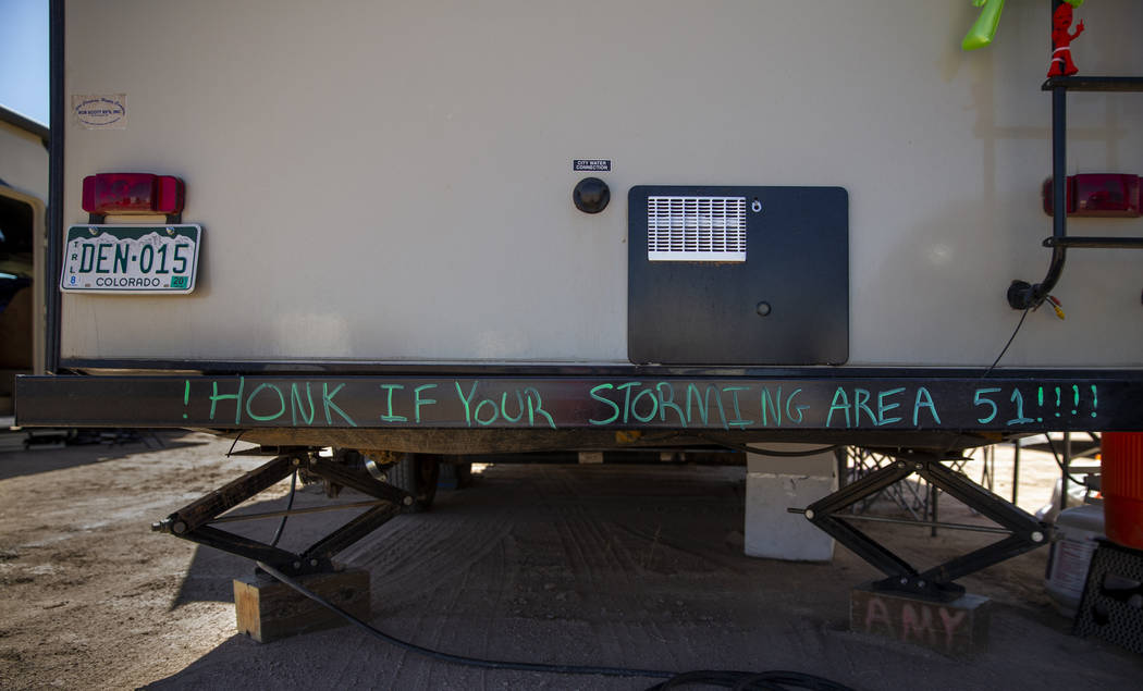 Sign on the bumper of an RV during the Alienstock festival on Friday, Sept. 20, 2019 in Rachel, ...