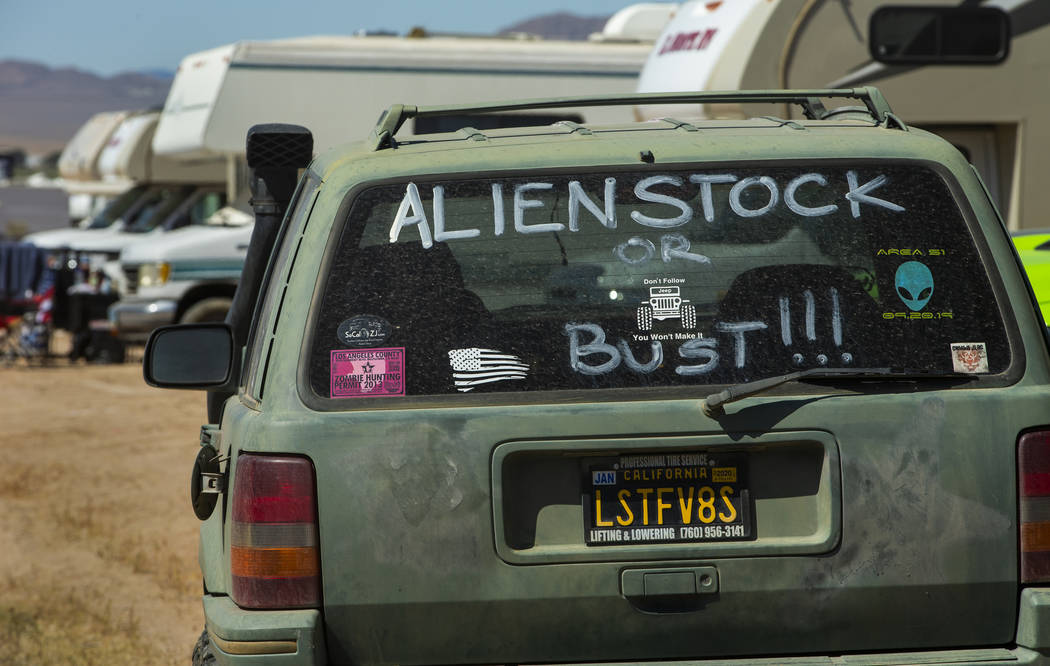 Sign on the rear window of a car during the Alienstock festival on Friday, Sept. 20, 2019 in Ra ...