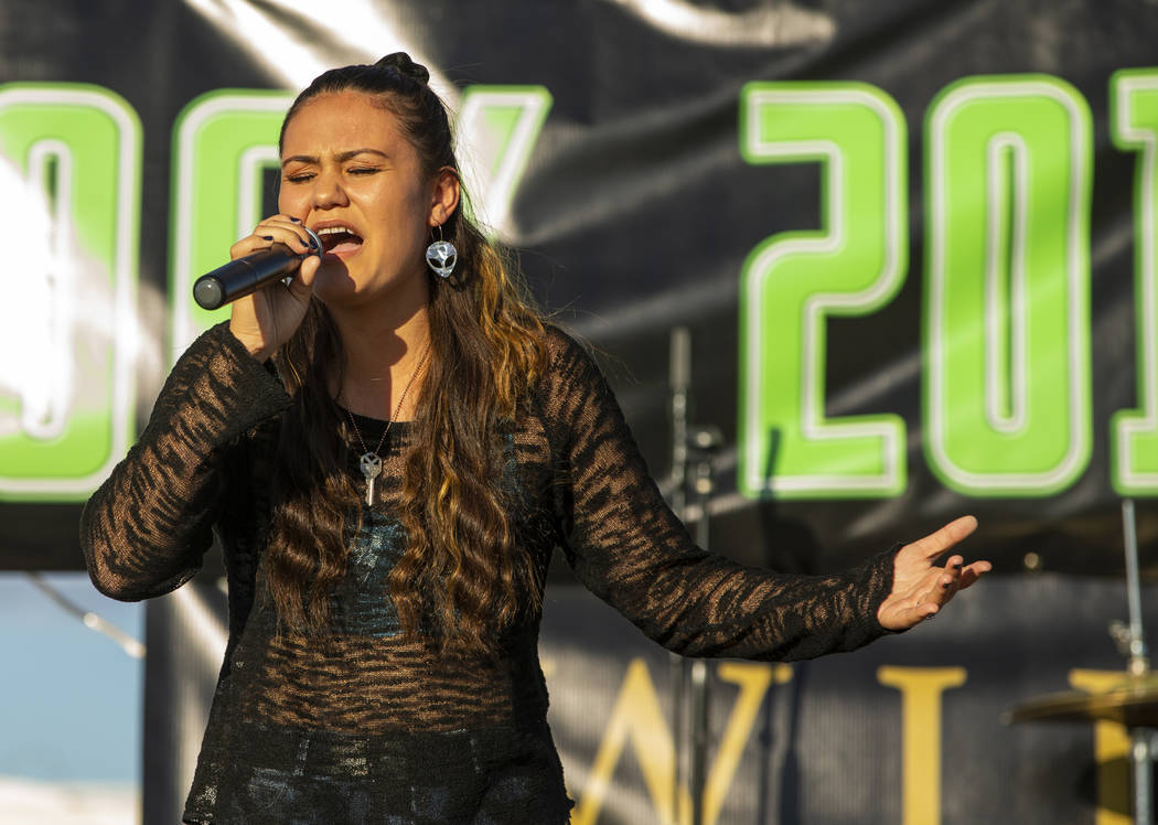Performer Elyse sings for the crowd on the main stage during the Alienstock festival on Friday, ...
