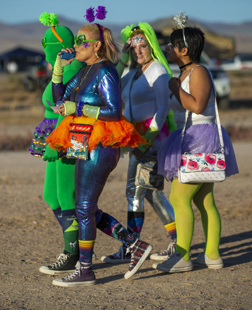 Festivalgoers are costumed up and wander about the grounds during the Alienstock festival on Fr ...