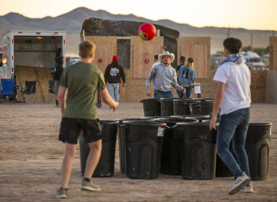 Festivalgoers play some trash can pong during the Alienstock festival on Friday, Sept. 20, 2019 ...