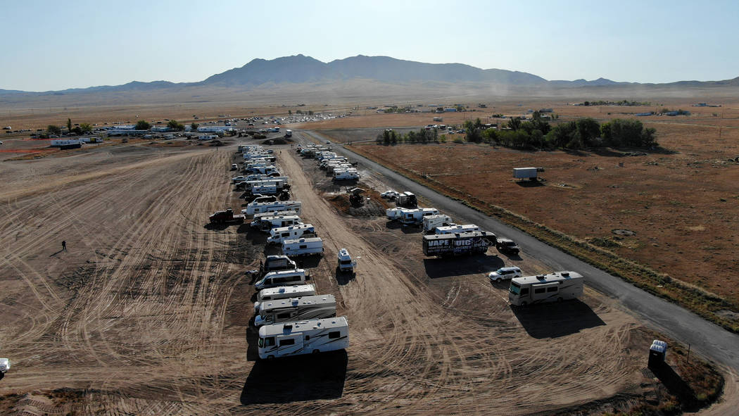 RVs line the back border of the Alienstock event grounds in Rachel, near Area 51, on Friday, Se ...