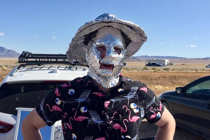 Chris Reid and his friend Justin Wainscott, both of Reno, are making free tin foil hats for tho ...
