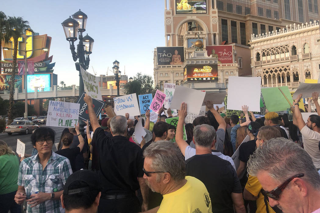 More than 100 people protest Friday, Sept. 20, 2019, outside The Venetian in Las Vegas as part ...