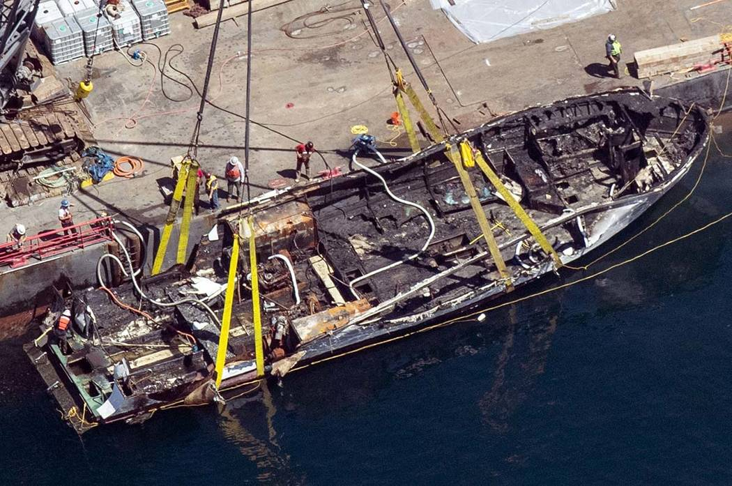 In a Sept. 12, 2019, file photo, the burned hull of the dive boat Conception is brought to the ...