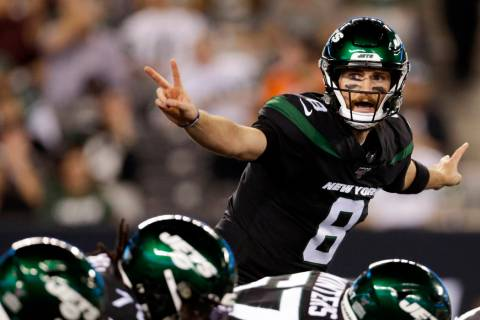 New York Jets' quarterback Luke Falk signals at the line of scrimmage during the second half ag ...