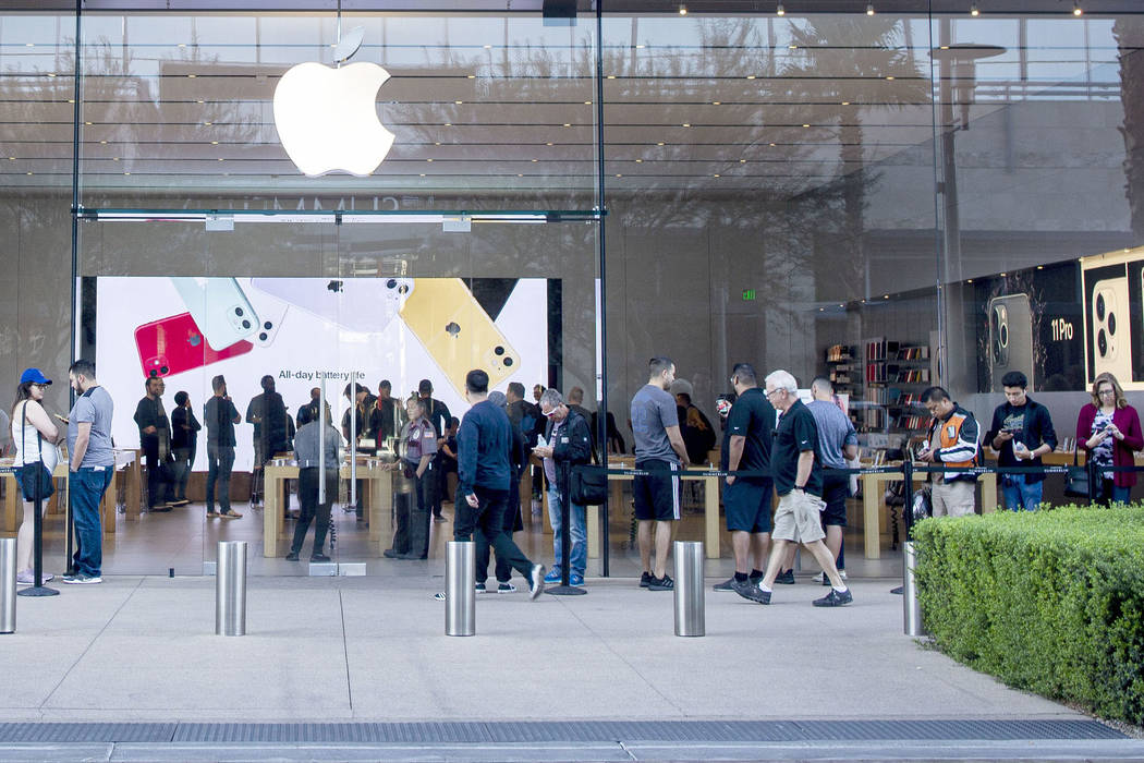 Individuals stand in line for the release of the new iPhone 11 at the Apple Store at Downtown S ...