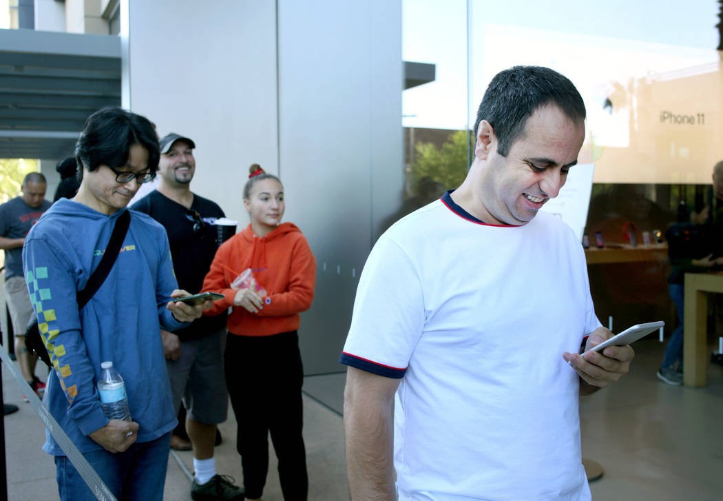 Las Vegas local Bledar Kodra stands at the head of the line with others for the release of the ...