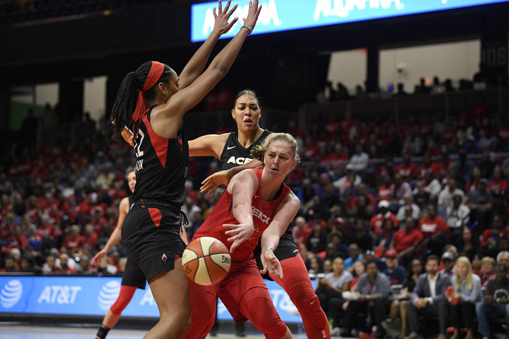 Washington Mystics center Emma Meesseman, right, passes th ball against Las Vegas Aces center A ...