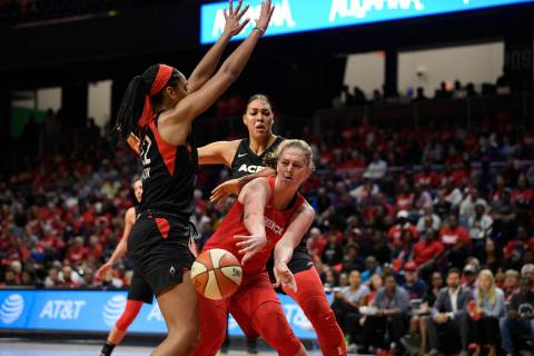 Washington Mystics center Emma Meesseman, right, passes th ball against Las Vegas Aces center A ...