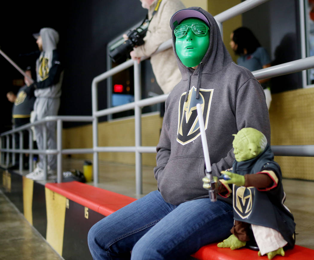 Las Vegas local Randall Keller watches the Golden Knights practice during an alien costume cont ...