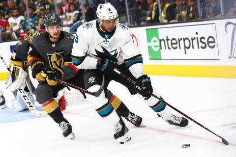 San Jose Sharks left wing Evander Kane (9) skates with the puck under pressure from Golden Knig ...