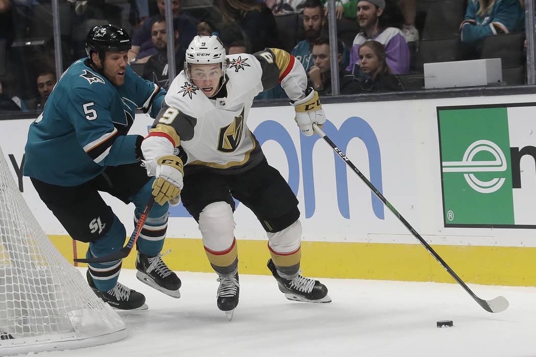 Vegas Golden Knights center Cody Glass (9) skates past San Jose Sharks defenseman Dalton Prout ...