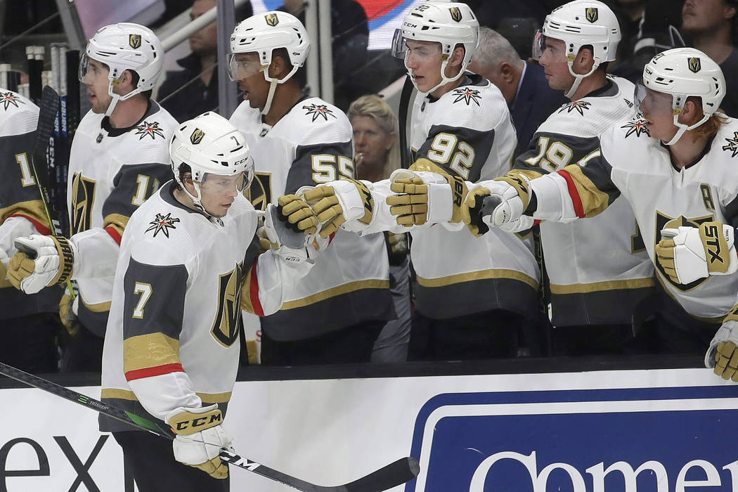 Vegas Golden Knights left wing Valentin Zykov (7) is congratulated by teammates after scoring a ...