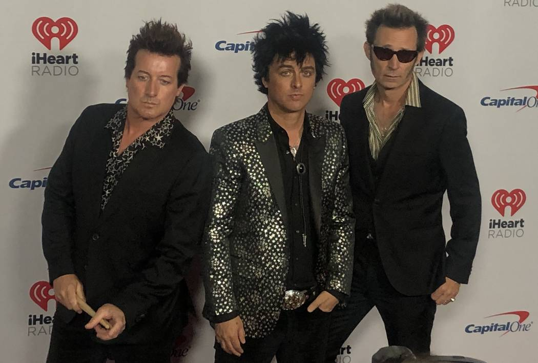 Tre Cool, Billie Joe Armstrong and Mike Dirnt of Green Day are shown on the red carpet at iHear ...