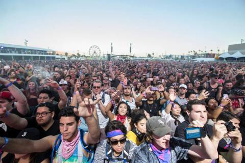 The crowd at the Downtown Stage erupts at the sight of 2 Chainz during the first day of the Lif ...