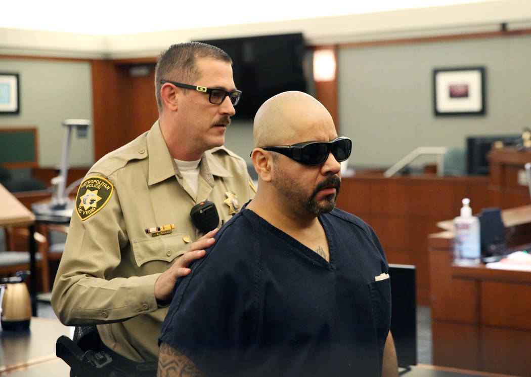 Gustavo Ramos-Martinez, convicted of killing two elderly people in 1998, is led out of the cour ...