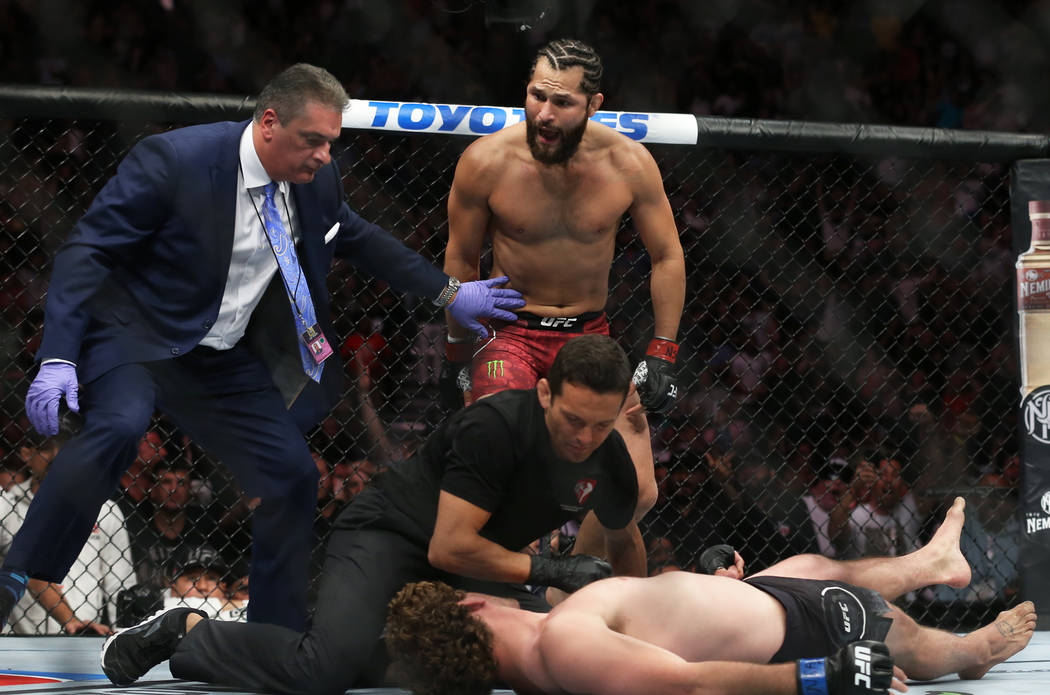 Jorge Masvidal, top, celebrates after knocking out Ben Askre in the first round during their we ...