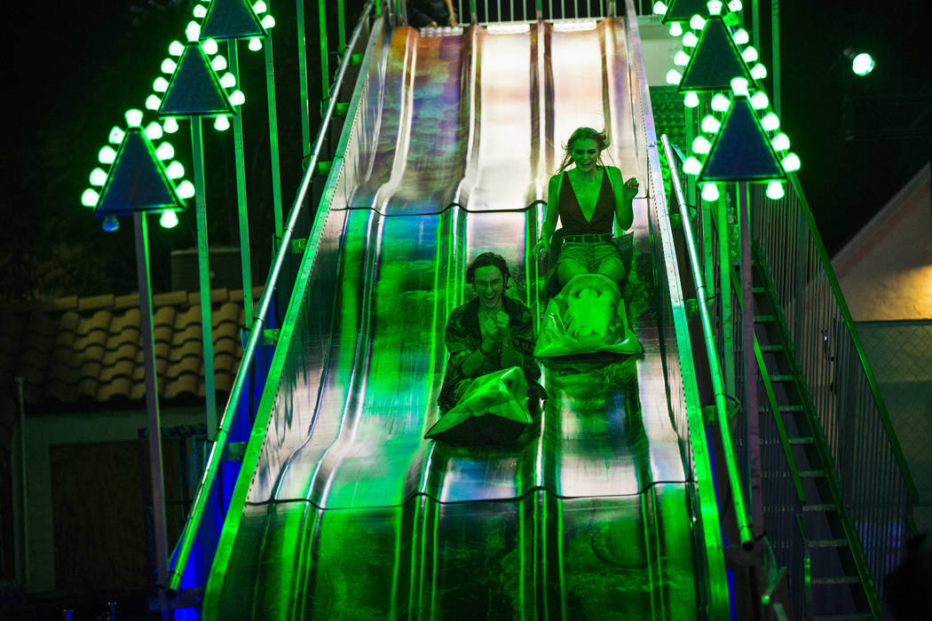 Massimo Greco, left, and Ryan Wiegand, both of Las Vegas, go down a slide during the first day ...