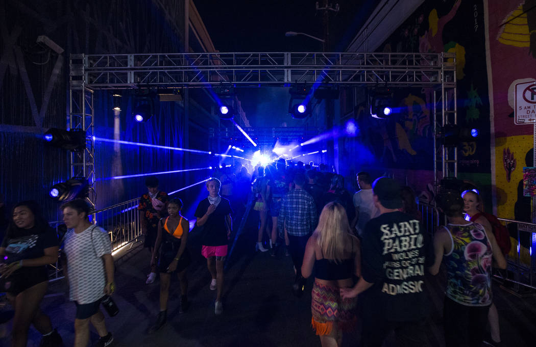 Attendees pass through an illuminated walkway during the first day of the Life is Beautiful fes ...