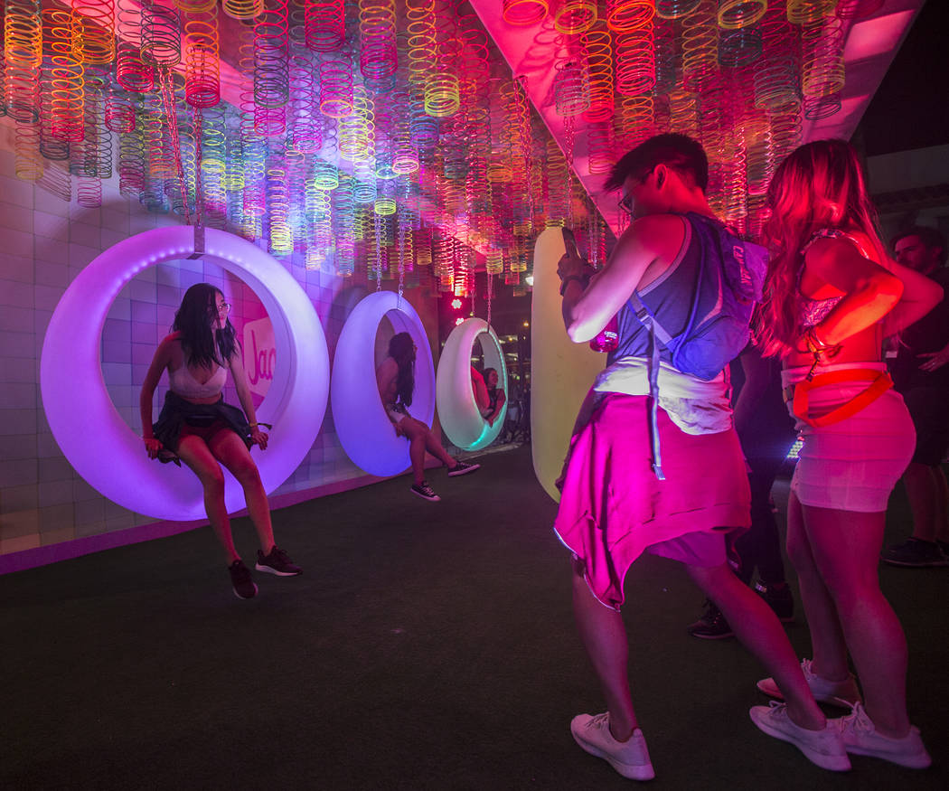 Festivalgoers pose for photos at Jack's Playground during the first day of Life is Beautiful on ...