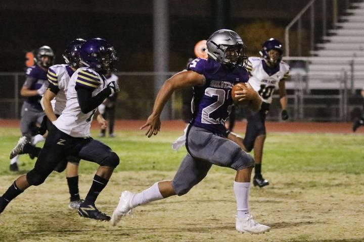 Silverado High's running back Breven Palpallatoc (23) runs for a 70-yard touchdown against Dura ...