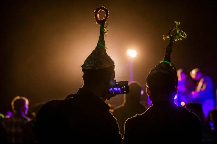Festivilgoers listen to DJ Naavi on the EDM stage on night two of the Alienstock festival on Fr ...