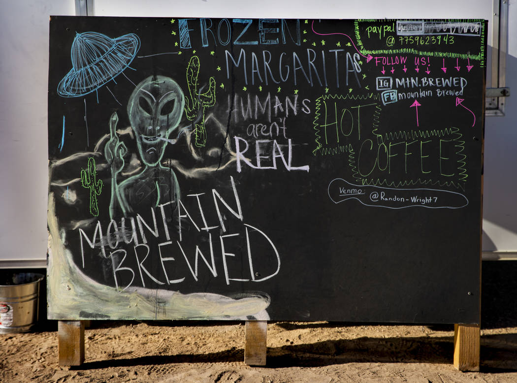 An alien sign for the margarita stand during the Alienstock festival on Saturday, Sept. 21, 201 ...