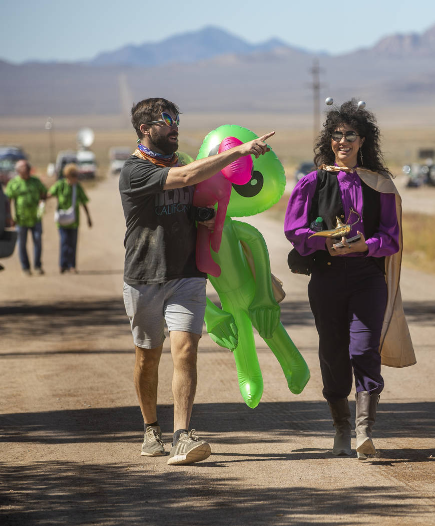 UNICULT members walk up the frontage road carrying aliens and a magic lamp during the Alienstoc ...