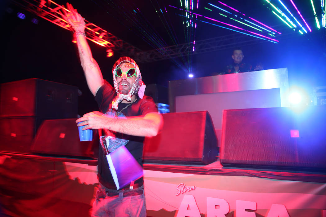A person dances during a performance by Grammy-nominated DJ Paul Oakenfold during the Alien Bas ...