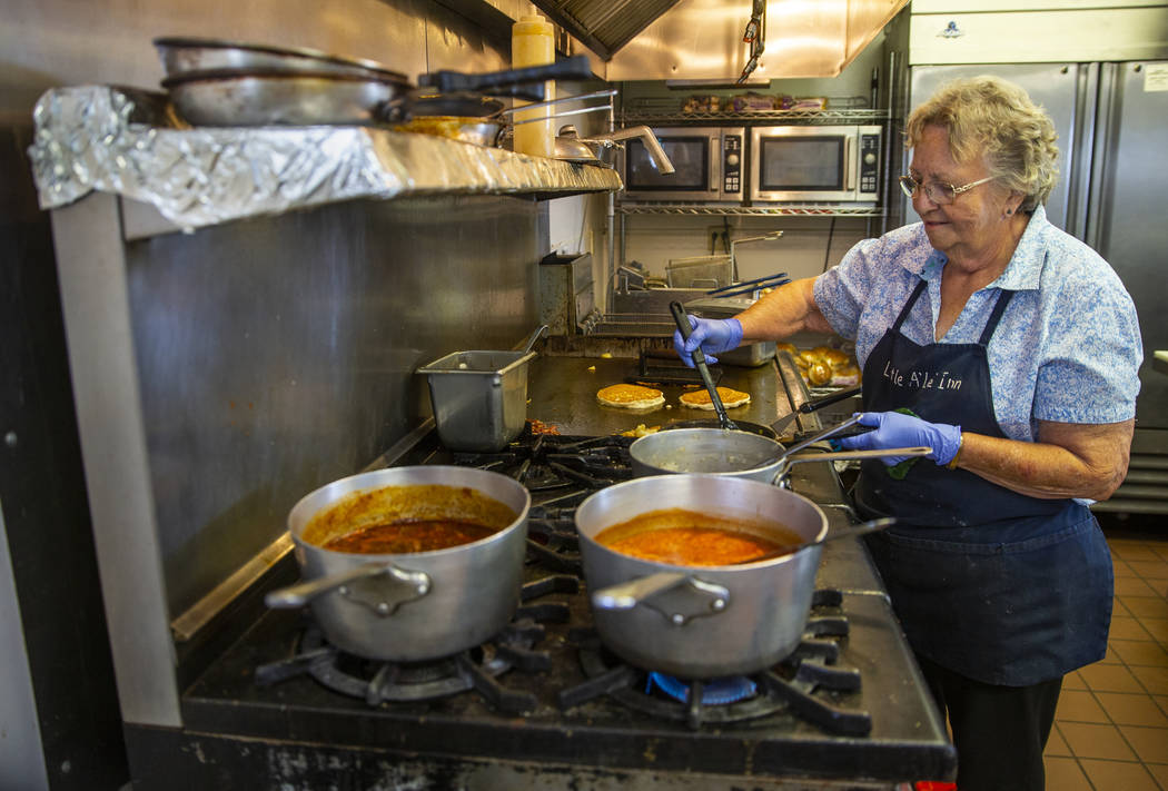 Pat Travis of the Little A'Le'Inn cooks breakfast for customers as usual and is preparing as mu ...