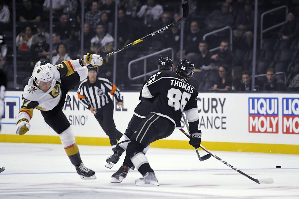 Vegas Golden Knights center Reid Duke, left, falls as Los Angeles Kings center Akil Thomas goes ...