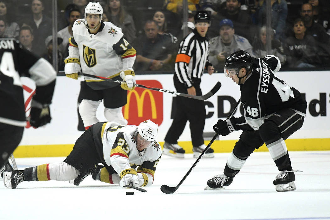 Vegas Golden Knights center Patrick Brown, lower left, passes the puck while under pressure fro ...
