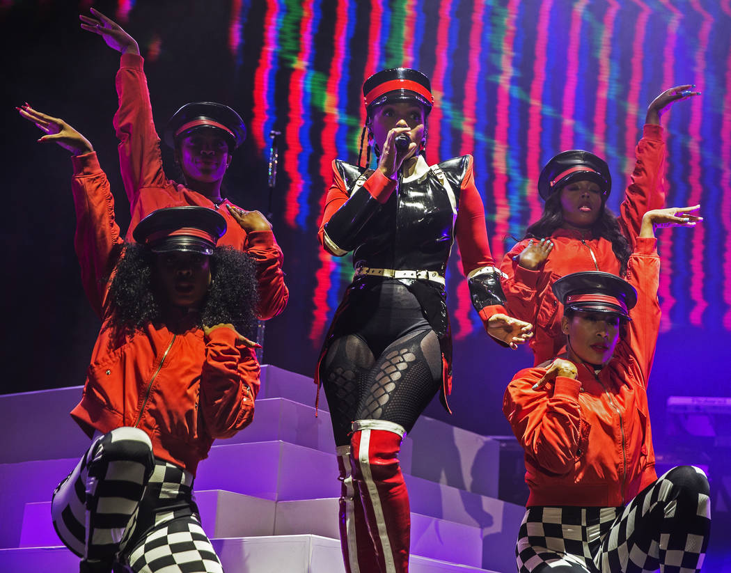 Janelle Monáe, middle, performs on the Bacardi Stage during the second day of Life is Beau ...
