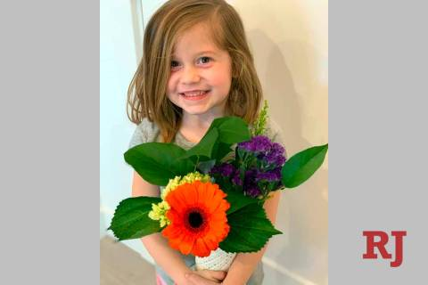 This Feb. 14, 2019 photo provided by her uncle, David Smith, shows Aria Hill posing with flower ...