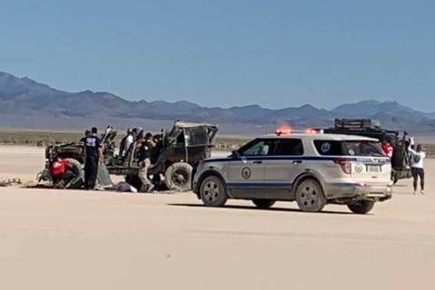 A black Jeep carrying three occupants rolled over around 10 a.m. Saturday, injuring two, with o ...