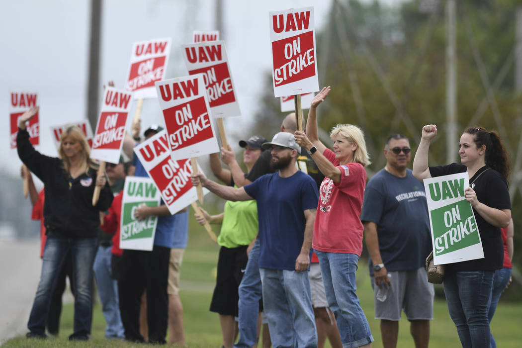 United Auto Workers members picket outside of the General Motors Lansing Delta Township plant M ...