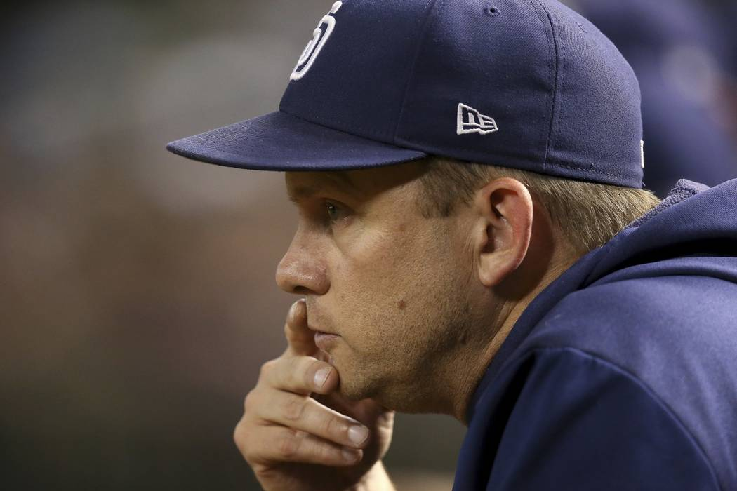 San Diego Padres manager Andy Green watches the action on the field during the third inning of ...