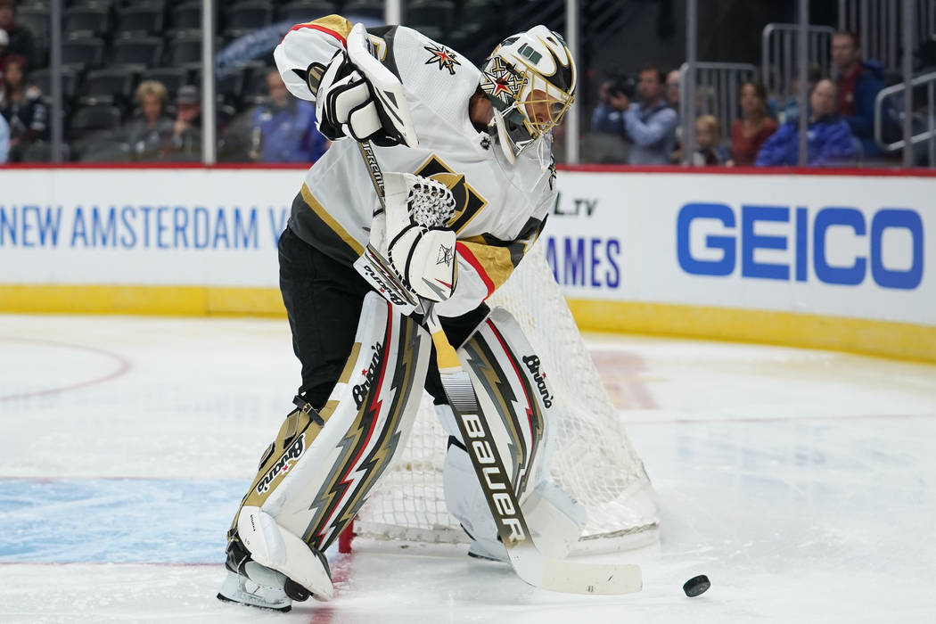 Vegas Golden Knights goaltender Garret Sparks clears the puck during a preseason NHL hockey gam ...
