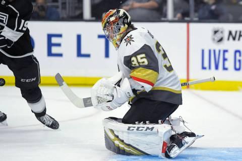 Vegas Golden Knights goaltender Oscar Dansk, right deflects a shot as Los Angeles Kings left wi ...