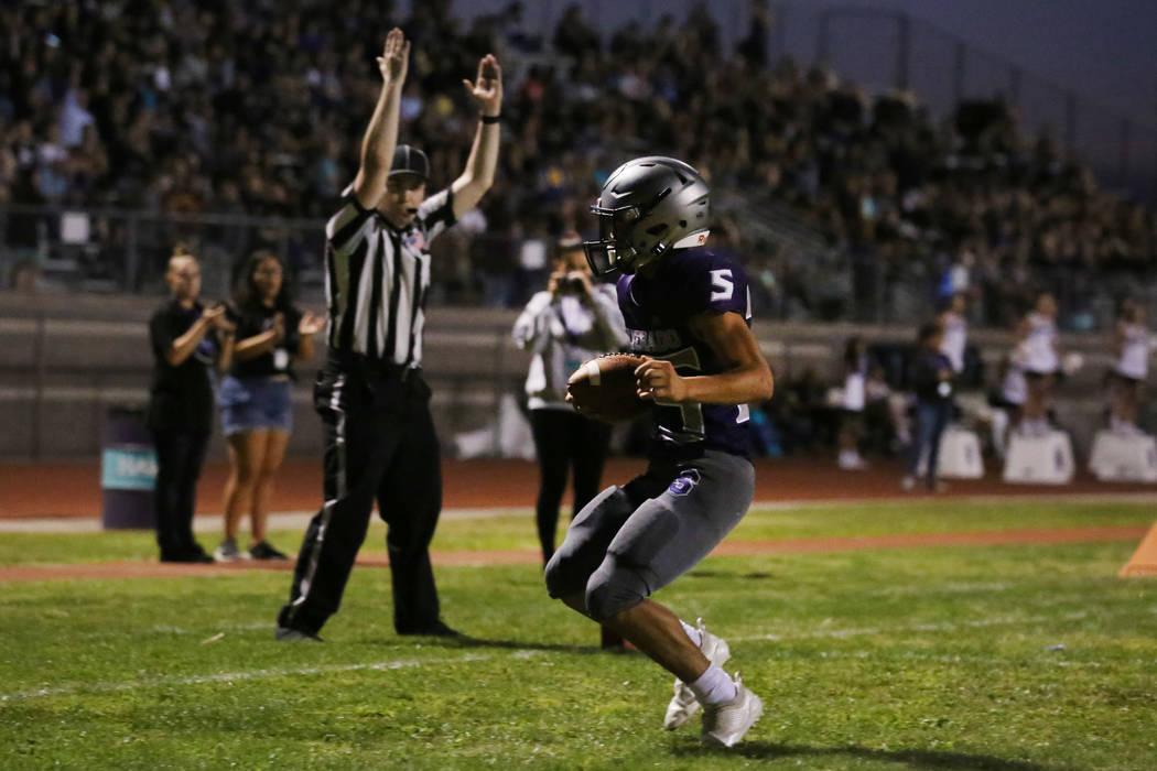 Silverado High's Jeremy Alipio (25) celebrates his touchdown against Durango High during the fi ...