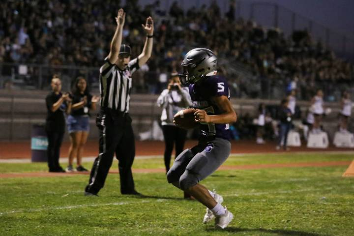 Silverado High's Jeremy Alipio (25) celebrates his touchdown against Durango High during the fi ...