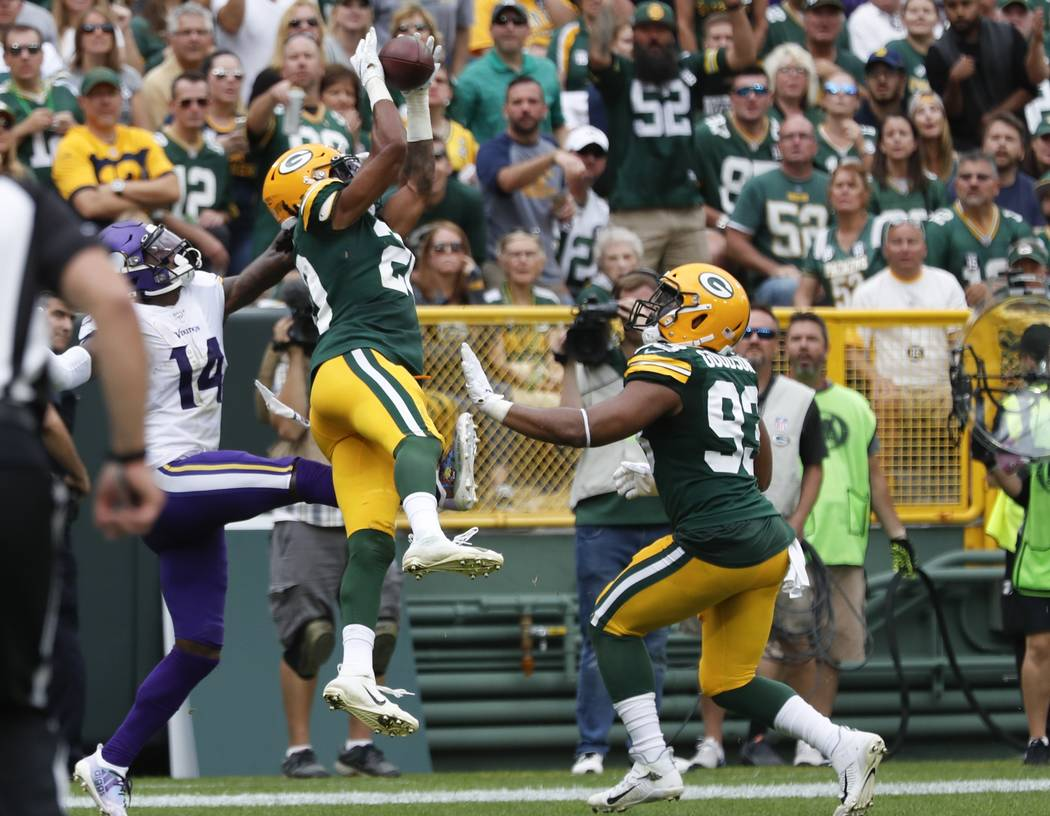 Green Bay Packers' Kevin King intercepts a pass intended for Minnesota Vikings' Stefon Diggs du ...