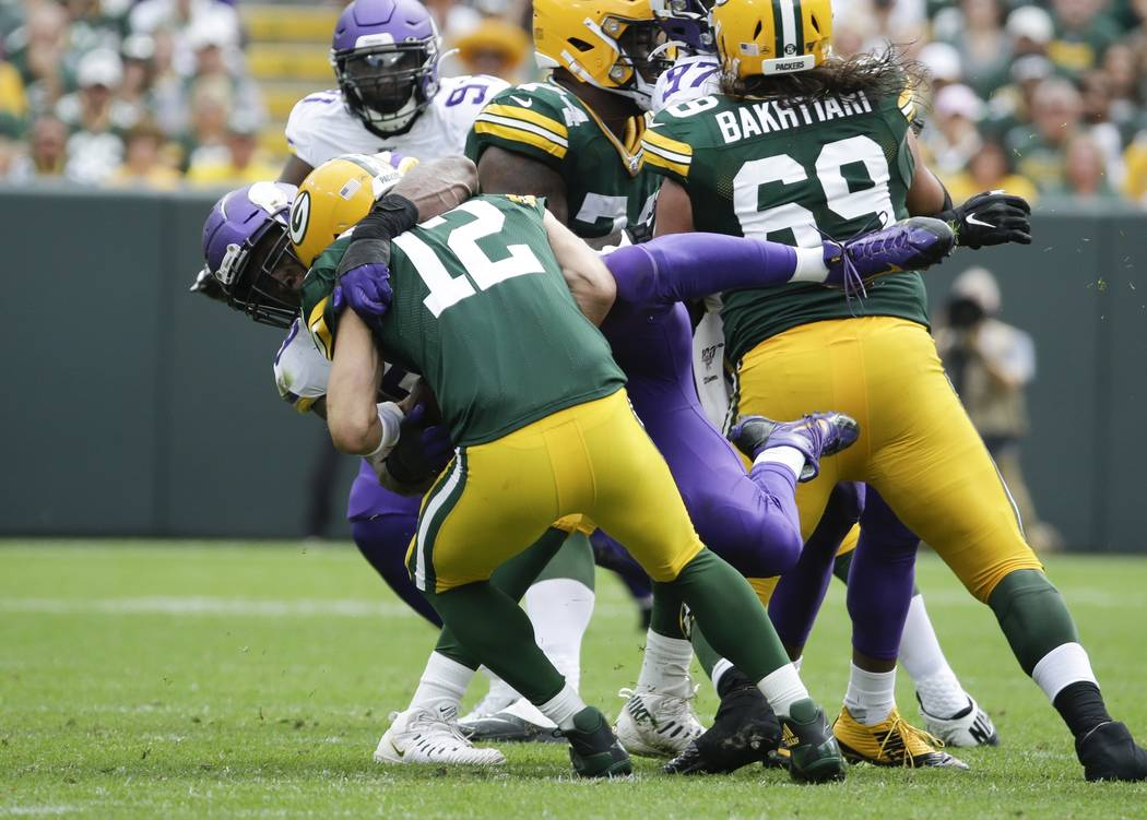 Minnesota Vikings' Danielle Hunter sacks Green Bay Packers' Aaron Rodgers during the second hal ...
