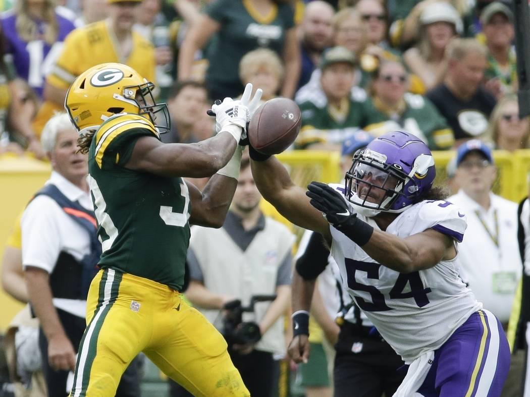 Minnesota Vikings' Eric Kendricks breaks up a pass intended for Green Bay Packers' Aaron Jones ...