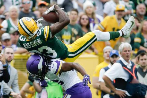 Minnesota Vikings' Trae Waynes breaks up a pass intended for Green Bay Packers' Marquez Valdes- ...