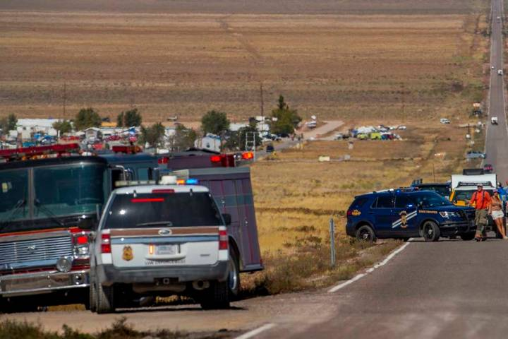 Emergency and medical personnel block off the Extraterrestrial Highway/State Route 375 for a po ...