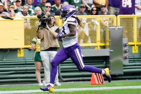 Minnesota Vikings' Dalvin Cook runs for a touchdown during the first half of an NFL football ga ...